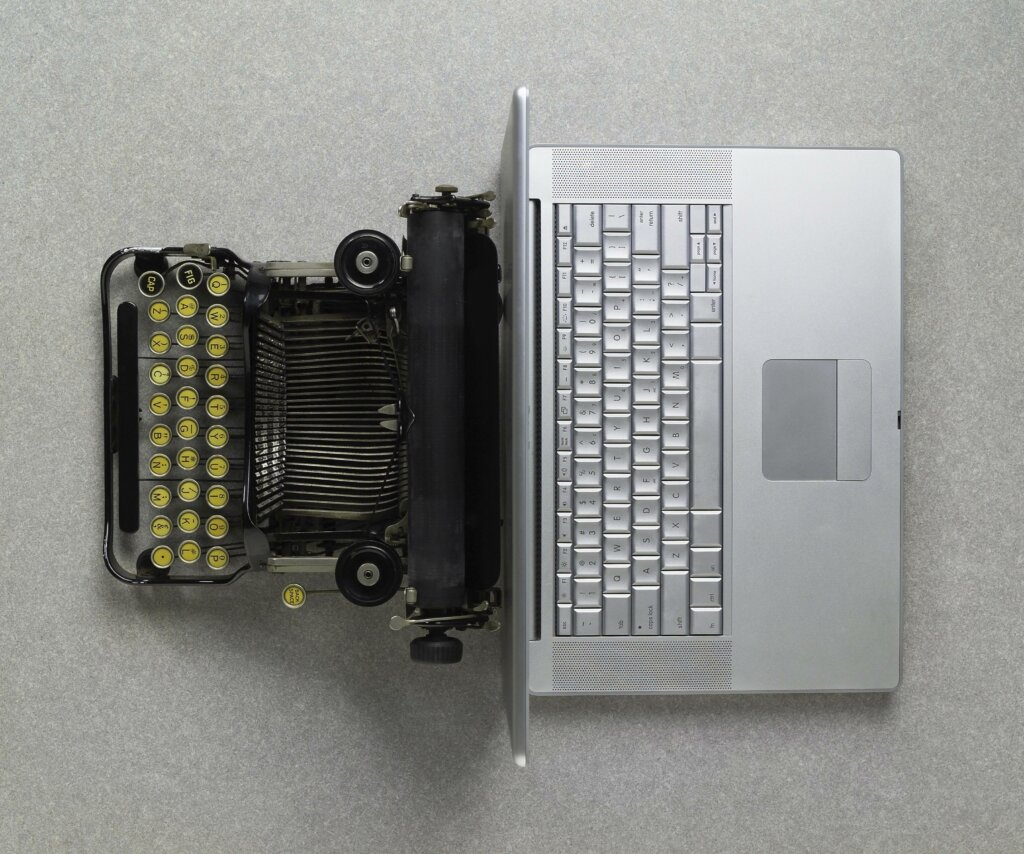 rise of word processing typewriter against notebook